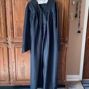 Standard black graduation robe.